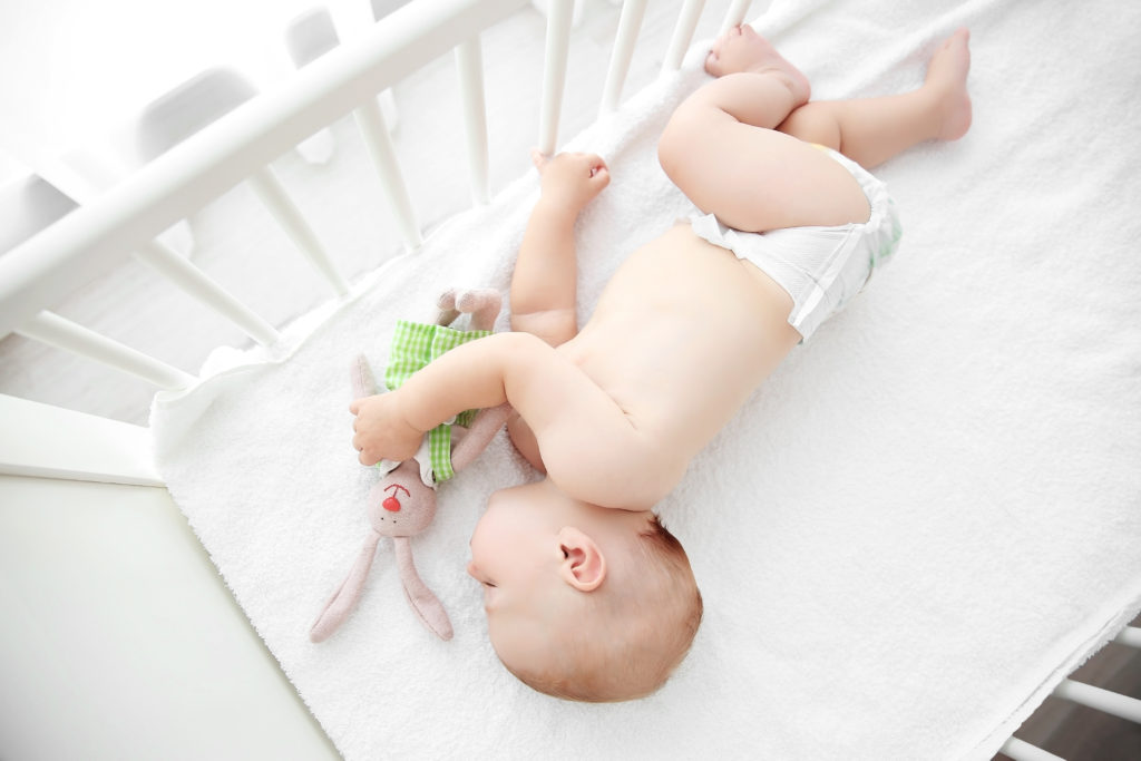 newborn sleeping in crib