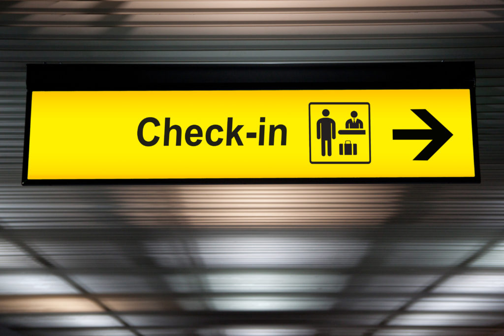 check in sign traveling